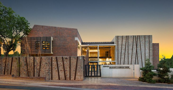 The Johannesburg Holocaust and Genocide Centre building lit up at night