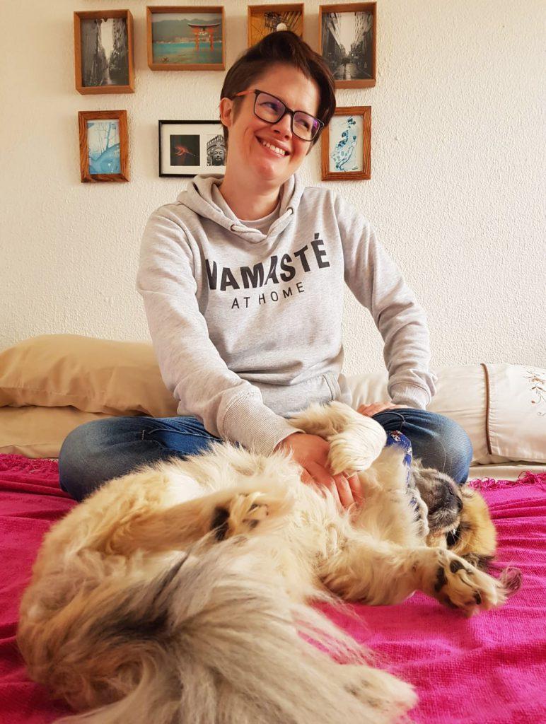 Joburg Blogger Ang Lloyd wearing a hoodie that says Namaste at home