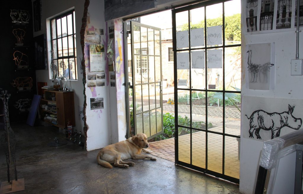 James Delaney's Labrador, Pablo, lies at the entrance to his Victoria Yards studio